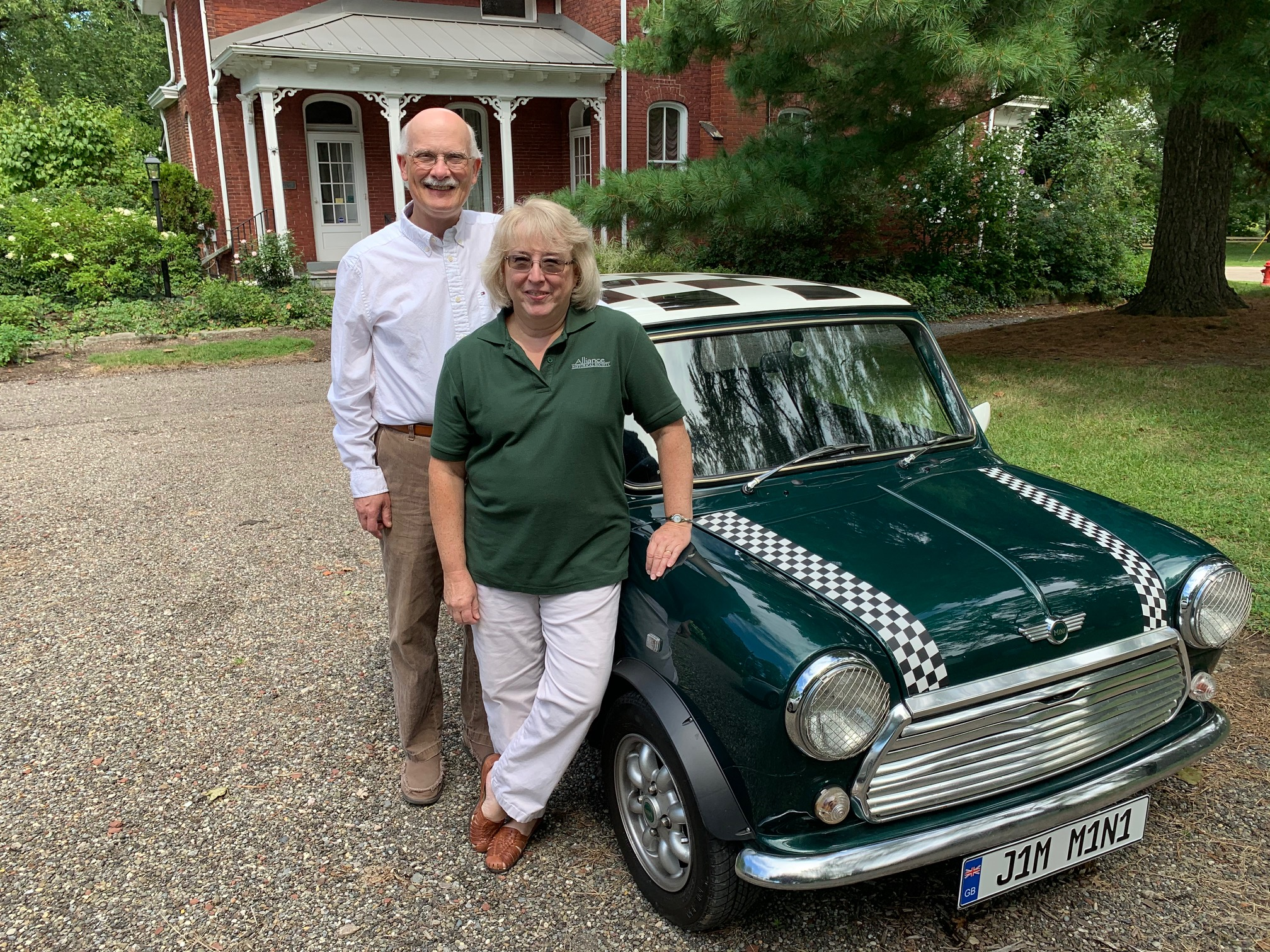 Jim and Karen Perone with their Mini at Mabel Hartzell Historical Home